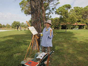 Artist painting in Italy during our art workshop in Tuscany