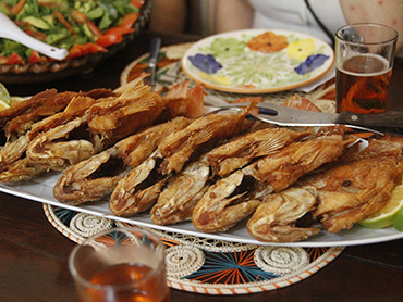 Dish with mojarra fish during Walk the Arts food tour in Colombia South America