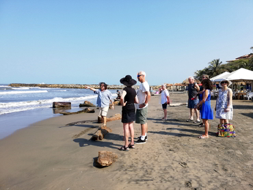 Group in front of the beach during Walk the Arts art and food workshop in South America