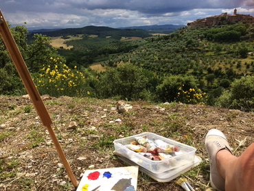 An easel and tubes of paint of one of our participants of Studio Italia our art workshop in Tuscany