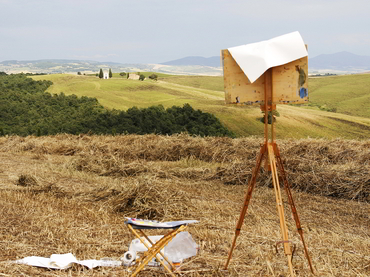 An easel with a painting by a participant of our plein air painting workshop in Tuscany Italy