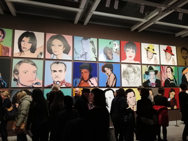 Group in front of artworks by Andy Warhol at the Whitney Museum during Walk the Arts New York City bus tour from Ottawa