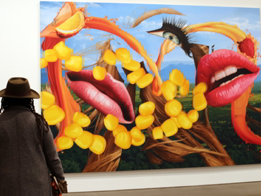 A person with a hat in front of a painting at a Chelsea Gallery during Walk the Arts New York City Tour from Ottawa