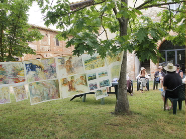 Artists discussing about their paintings during our art workshop in Tuscany