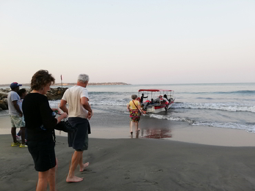 Group taking a boat in Cartagena during Walk the Arts winter holiday art and food workshop in South America
