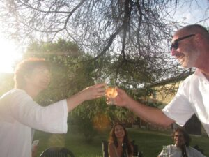 Husband toasting with student